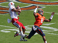 Ball State wide receiver Willie Snead (3) makes a catch next to Virginia safety Anthony Harris (8) during the football game Saturday Oct. 5, 2013 at Scott Stadium in Charlottesville, VA. Ball State defeated Virginia 48-27. Photo/The Daily Progress/Andrew Shurtleff