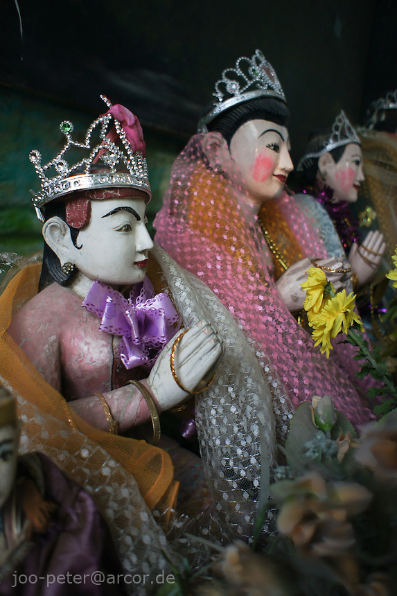 typical Nat shrine in  Mandalay, Myanmar, 2011. Worshipping of Nat spirits, an old animistic belief is common in Myanmar and co-exists with Buddhism