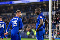 Sol Bamba of Cardiff City looks dejected despite the words of Anthony Pilkington at full time of the Sky Bet Championship match between Cardiff City and Wolverhampton Wanderers at the Cardiff City Stadium, Cardiff, Wales on 6 April 2018. Photo by Mark  Hawkins / PRiME Media Images.