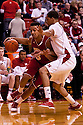 27 December 2011: Ryan Evans #5 of the Wisconsin Badgers drives around Toney McCray #0 of the Nebraska Cornhuskers during the first half at the Devaney Sports Center in Lincoln, Nebraska. Wisconsin defeated Nebraska 64 to 40.