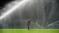 A member of the Milton Keynes Dons' ground staff tends to the pitch amongst the water sprinklers<br /> <br /> Photographer Chris Vaughan/CameraSport<br /> <br /> The EFL Sky Bet League One - Milton Keynes Dons v Lincoln City - Saturday 19th September 2020 - Stadium MK - Milton Keynes<br /> <br /> World Copyright © 2020 CameraSport. All rights reserved. 43 Linden Ave. Countesthorpe. Leicester. England. LE8 5PG - Tel: +44 (0) 116 277 4147 - admin@camerasport.com - www.camerasport.com