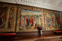 BNPS.co.uk (01202 558833)<br /> Pic: ZacharyCulpin/BNPS<br /> <br /> Renaissancespring clean<br /> <br /> Tapestry technician, Myra Body works on 'Christ's Charge to Peter' <br /> <br /> The annual spring clean of the Mortlake Tapestriesat Forde Abbey in Dorset.<br /> <br /> They took over 3 weeks to clean, a scaffolding platform was used to reach the top of the 18 foot historic works of art.<br /> <br /> The tapestries are hung on the walls in The Saloon of Forde Abbey, They are woven from the cartoons painted by Renaissance master Raphael, they depict the scenes from the lives of St Peter and St Paul, as described in St John's Gospel and Acts of the Aspostles. <br /> <br /> The original tapestries were commissioned for the Sistine Chapel, in Rome, by Pope Julius II, and were first woven in Brussels in about 1520. This set was made in London at the Mortlake factory about hundred years later.<br /> <br /> Raphael's cartoons depicted in the tapestries include: The Miraculous Draft of Fishes, Panel from 'The Death of Ananias,' The Healing of the Lame Man, Christ's charge of St Peter and The Sacrifice at Lystra before St Paul and St. Barnabus.<br /> <br /> Forde Abbey is a former Cistercian monastery in West Dorset dating back to the early 12th century.