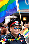 Police officer participating in gay and lesbian Pride parade in Toronto Canada 2008