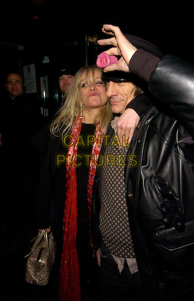 JO HOWARD & RONNIE WOOD.Kate Moss' 34th birthday party, Punk bar & club, London, England..January 16th, 2008.half length black coat leather jacket hat pink nose red scarf married couple husband wife polka dot arm over shoulder .CAP/CAN.©Can Nguyen/Capital Pictures