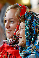 NWA Democrat-Gazette/DAVID GOTTSCHALK  Liya Yakupova (left), of Ufa, Russia and graduate student at the University of Arkansas, wears a platok, a traditional scarf with Gwynne Gertz, with the English Department at the University, Monday, November 16, 2015 in the Arkansas Union International Connections Lounge on the campus in Fayetteville. The students were participating in the International Student Organization Bazaar presented by the International Student Organization at the University of Arkansas on the first day of International Education Week. The bazaar featured displays, food and entertainment from 18 different countries and asked students to wear traditional attire from their country.