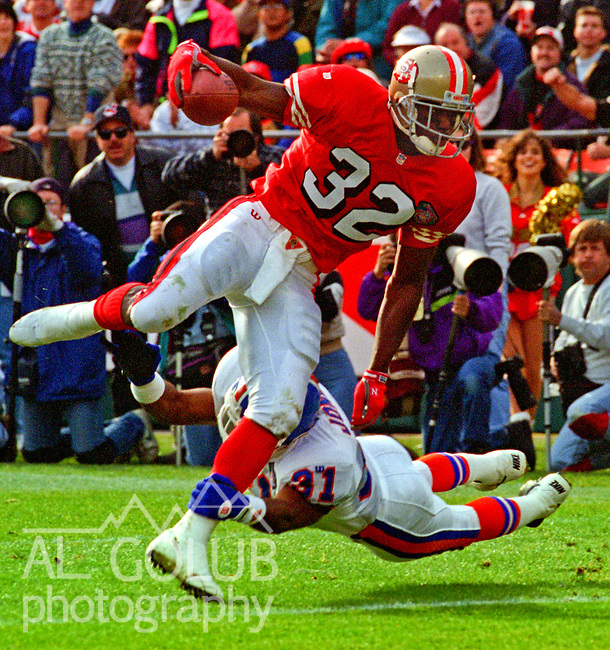 San Francisco 49ers vs. Denver Broncos at Candlestick Park Saturday, December 17, 1994.  49ers beat Broncos 42-19.  Denver Broncos defensive back Rondell Jones (31) holds on to San Francisco 49ers running back Ricky Watters (32).