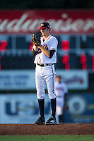Danville Braves starting pitcher Ian Anderson (12) looks to his catcher for the sign against the Burlington Royals at American Legion Post 325 Field on August 16, 2016 in Danville, Virginia.  The game was suspended due to a power outage with the Royals leading the Braves 4-1.  (Brian Westerholt/Four Seam Images)
