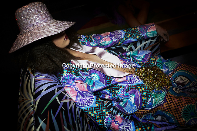 CAPE TOWN, SOUTH AFRICA - JULY 26: A model rests in a chair during an installation show at the new Klûk CGDT flagship store during Mercedes-Benz Fashion Week on July 26, 2014, in Cape Town, South Africa. Klûk CGDT, created by the designers Malcolm KLûK and Christiaan Gabriel Du Toit. The elite of Cape Town came out for the launch of the store and the late night party. (Photo by Per-Anders Pettersson)
