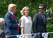 United States President Donald J. Trump, left, walks with Sherry Pollex, center and Martin Truex Jr., left, the NASCAR Cup Series champion, on the South Lawn of the White House in Washington, DC on Monday, May 21, 2018.  Truex competes full-time in the Monster Energy NASCAR Cup Series for Furniture Row Racing.  Ms. Pollex is the longtime girlfriend of Truex Jr. who has been battling ovarian cancer since 2014.<br /> Credit: Ron Sachs / CNP