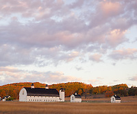 Sleeping Bear Dunes National Lakeshore, MI:  Colorful sunrise clouds over the historic D. H. Day Farm and forested hills in fall near Glen Haven
