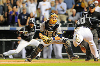 19 JUNE 2010: Milwaukee Brewers catcher Jonathan Lucroy prepares to tag Colorado Rockies infielder Chris Nelson at the plate during a regular season Major League Baseball game between the Colorado Rockies and the Milwaukee Brewers at Coors Field in Denver, Colorado. Nelson scored when Lucroy lost control of the ball as the two collided at home plate.  The Rockies beat the Brewers 8-7. *****For Editorial Use Only*****