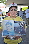 Maria de Jesus Silva Velasquez holds photos of disappeared family members during a December 16, 2013 demonstration in the southern Mexico city of Tapachula.<br /> A Nicaraguan, Silva was part of a caravan of 45 people from Central America who spent 17 days touring 14 Mexican states in search of their loved ones, most of whom had disappeared while following the migrant trail north. <br /> <br /> Silva holds photos of her daughter Jacqueline Silva Giron, who was kidnapped by traffickers in 2004 at the age of 11. Silva has identified the woman responsible for the abduction, but has been unable to locate her daughter for nine years. The second photo she holds is of her nephew Humberto Mayorga Silva, who left in 2007 when he went to search for Silva's daughter. He last called in 2011 but hasn't been heard from since.