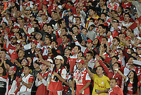 BOGOTÁ-COLOMBIA-12-05-2015. Hinchas de Independiente Santa Fe animan a su equipo durante partido de vuelta entre Independiente Santa Fe de Colombia y Estudiantes de La Plata por octavos de final, llave F, de la Copa Bridgestone Libertadores 2015 jugado en el estadio Nemesio Camacho El Campin de la ciudad de Bogota.  / Fans of Independiente Santa Fe cheer for their team during a second leg match between Independiente Santa Fe of Colombia and Estudiantes de La Plata de Argentina for the round of sixteen, Key F, of the Copa Bridgestone Libertadores 2015 played at Nemesio Camacho El Campin stadium in Bogota city.  Photo: VizzorImage/ Gabriel Aponte /Staff