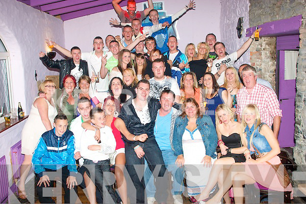 0530-0533.---------.Birthday Bash.-------------.David Tarmey(seated 5th from the Rt)of Rahoonane,Tralee,celebrated his 30th birthday in the GreyHound bar,Pembroke St,Tralee,last Saturday night with many family and friend's.