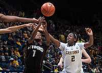 Afure Jemerigbe of California fights for a loose ball against Lili Thompson of Stanford during the game at Haas Pavilion in Berkeley, California on February 2nd 2014.   Stanford defeated California, 79-64.