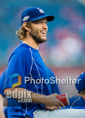 13 October 2016: Los Angeles Dodgers starting pitcher Clayton Kershaw stretches out prior to the NLDS Game 5 against the Washington Nationals at Nationals Park in Washington, DC. The Dodgers edged out the Nationals 4-3, taking the Series 3 games to 2 and moving on to the National League Championship Series against the Chicago Cubs. Mandatory Credit: Ed Wolfstein Photo *** RAW (NEF) Image File Available ***