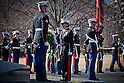 Maj. Gen. Angela Salinas, director of the Marine Corps' Manpower Management Division, and Lance Cpl. Austin Benz, a Marine Corps Body Bearer with Marine Barracks Washington, lay a ceremonial wreath at the Marine Corps War Memorial Feb. 23, 2011. The ceremony marked the 66th anniversary of the flag raising on Mt. Suribachi during the battle of Iwo Jima. (Photo by USMC/AFLO)