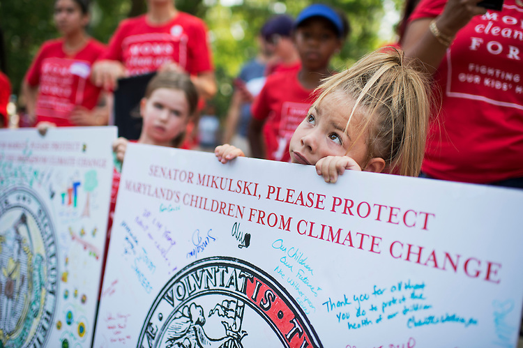 """UNITED STATES - JULY 7: Lilyana Distler, 4, of Waldorf, Md., holds a sign during a """"play-in"""" protest by kids and mothers in Upper Senate Park organized by Moms Clean Air Force, July 7, 2015. About 400 gathered to support the EPA's Clean Power Plan and call attention to climate change and air pollution. (Photo By Tom Williams/CQ Roll Call)"""