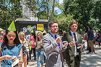 Visitors to Madison Square Park in New York are treated to a free Breyers ice cream on Wednesday, June 22, 2016. Breyers is giving away the summer treat as a celebration of the company's 150th anniversary. Besides the dessert visitors had the opportunity to meet various celebrities that Breyers had brought in. Breyers is a brand of the giant conglomerate Unilever. (© Richard B. Levine)