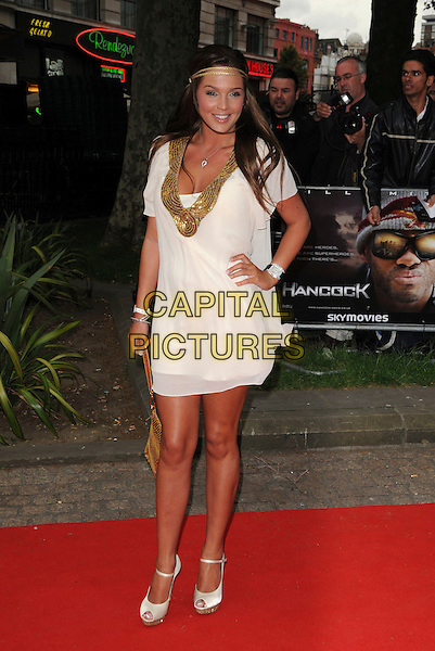 "DANIELLE LLOYD.Attending the UK Gala Premiere of ""Hancock"" at Vue West End, Leicester Square, London, England, UK, June 18th 2008..full length white gold trim dress hand on hip headband hairband brunette hair bag peep toe shoes.CAP/CAS.©Bob Cass/Capital Pictures"