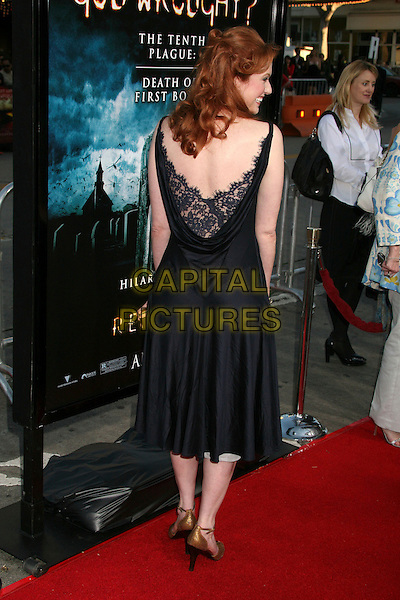 "ANDREA FRANKLE.""The Reaping"" Los Angeles Premiere at Mann's Village Theatre, Hollywood, California, USA, 29 March 2007..full length black dress lace back behind.CAP/ADM/BP.©Byron Purvis/AdMedia/Capital Pictures."