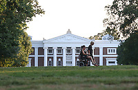 Former UVa student Jasmine Korur, left, rides across the lawn with her mother Sarah Nagar, right, on campus at the University of Virginia in Charlottesville, Va. Photo/Andrew Shurtleff