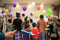 People selling party paraphenalia like balloons and hats during Queen Elizabeth II birthday celebrations at the Barking Community Centre in East London.