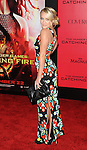 Emily Osment arriving to 'The Hunger Game Catching Fire Premiere', Los Angeles, Ca. November 18, 2013.