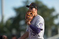 Salt River Rafters third baseman Josh Fuentes (19), of the Colorado Rockies organization, yells into his glove after a runner beat his throw to first base during the Arizona Fall League Championship Game against the Peoria Javelinas at Scottsdale Stadium on November 17, 2018 in Scottsdale, Arizona. Peoria defeated Salt River 3-2 in 10 innings. (Zachary Lucy/Four Seam Images)