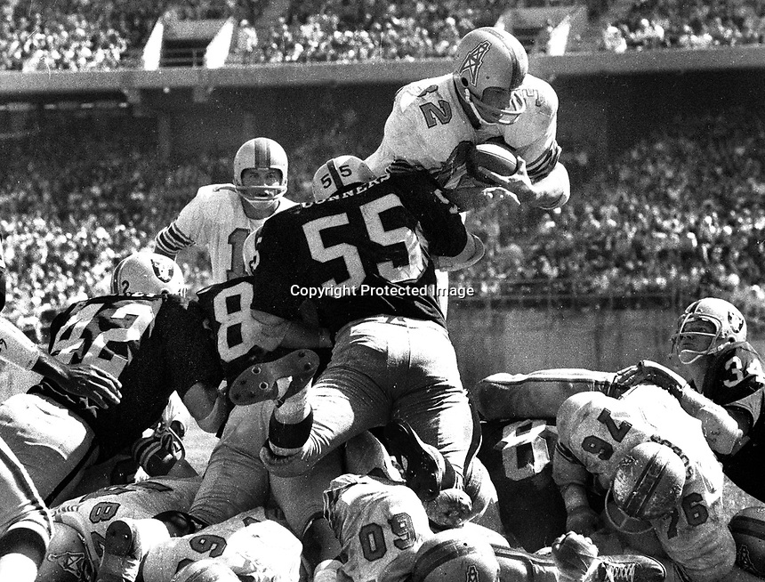 Houston Oiler Hoyle Granger dives over the top stoped by the Oakland Raiders Dan Conners and a host of teamates. (1969 photo/Ron Riesterer)