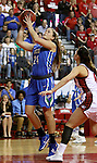 VERMILLION, SD, APRIL 2:  Taylor Gradinjan #24 from Florida Gulf Coast lays the ball up past Tia Hemiller #4 from the University of South Dakota during the WNIT Championship game Saturday afternoon at the Dakota Dome in Vermillion, S.D. (Photo by Dave Eggen/Inertia)