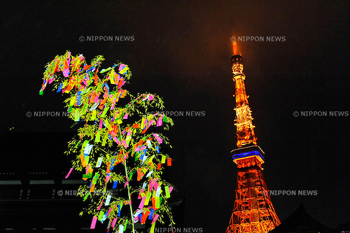 July 7th, 2012 : Tokyo, Japan -  A bamboo with people's wishes was lightened up as Tokyo Tower, one of Tokyo's famous sightseeing spots, was seen behind at Tanabata Festival, a traditional festival on July 7 every year, at Zojoji, or Zojo Temple, at Shibakouen, Minato, Tokyo, Japan on July 7, 2012.  Even though the festival was supposed to celebrate stars, it was raining and cloudy this year. (Photo by Koichiro Suzuki/AFLO).