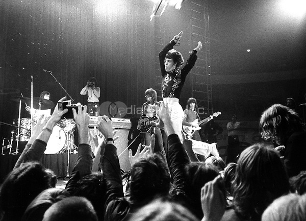 "The British rock band ""The Rolling Stones"" during a concert in front of enthusiastic fans at the Deutschlandhalle in Berlin, West Germany on 16.09.1970. In the middle lead singer Mick Jagger. 