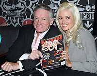 "27 September 2017 - Hugh Marston Hefner aka ""Hef"" was an American magazine publisher, editor, businessman, and international playboy best known as the editor-in-chief and publisher of Playboy magazine, which he founded in 1953. Hefner was the founder and chief creative officer of Playboy Enterprises, the publishing group that operates the magazine. Hefner was also a political activist and philanthropist. File Photo: 11 October 2005 - Virgin Megastore Times Square, NYC - Hugh Hefner and Holly Madison sign copies of Nov. 2005 issue of Playboy Magazine.  Photo Credit Jackson Lee/AdMedia"