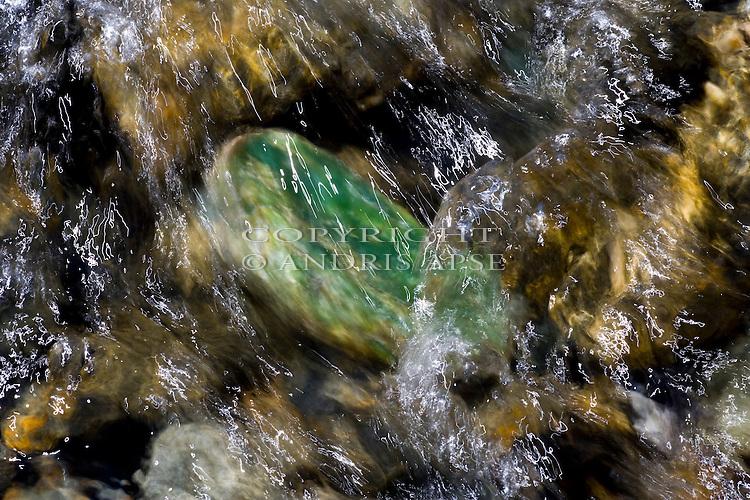 Closeup of Pounamu (jade) stone in river. New Zealand.