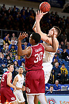 BROOKINGS, SD - JANUARY 13: Mike Daum #24 from South Dakota State University takes the ball to the basket against Donoven Carlisle #30 from Denver during their game Saturday afternoon at Frost Arena in Brookings, SD.  (Photo by Dave Eggen/Inertia)