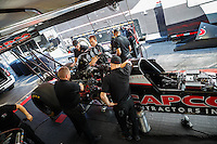Feb 12, 2016; Pomona, CA, USA; Crew members for NHRA top fuel driver Steve Torrence during qualifying for the Winternationals at Auto Club Raceway at Pomona. Mandatory Credit: Mark J. Rebilas-USA TODAY Sports