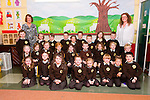 Mrs Olive Ui Ghearains (right) class pictured on their first day of school at Gaelscoil Mhic Easmainn national school, Tralee on Friday with An Priomhoide, Cait Ui Chonchuir