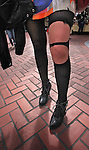 A young lady's with torn stockings walking the farmers market in San Francisco California.