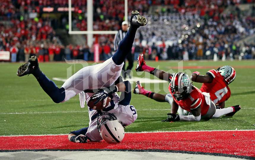 Penn State Nittany Lions wide receiver Brandon Felder (85) catches a touchdown behind Ohio State Buckeyes cornerback Bradley Roby (1) and safety C.J. Barnett (4) during the first half of the NCAA football game at Ohio Stadium in Columbus on Oct. 26, 2013. (Adam Cairns / The Columbus Dispatch)