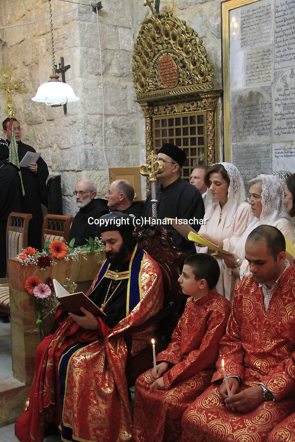 Easter, Syrian Orthodox Archbishop Mar Malki Murad presides over the Maundy Thursday ceremony at the Syrian Orthodox St. Mark's Church in Jerusalem