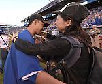 Norichika Aoki (Royals),<br /> OCTOBER 15, 2014 - MLB : Norichika Aoki (L) of the Kansas City Royals celebrates with his wife Sachi after winning the Major League Baseball American League championship series Game 4 at Kauffman Stadium in Kansas City, Missouri, USA. <br /> (Photo by AFLO)