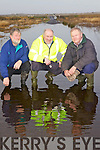 John Canty, Jerry Buckley and Andrew Sheehy from Lixnaw pictured last Friday on the flooded road leading to the newly constructed Ballinagare bridge which has been impassible for local road users.  .