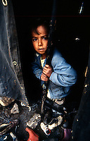 Isikveren - Kurdistan - Turckey/Iraq Border - April 1991.Consequences of Gulf War..Refugee camp for the kurdish refugees fled from North Iraq..In the picture the hard conditions of life for children living in the tents..Photo Livio Senigalliesi