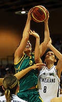 Opals forward Hollie Grima and Ferns forward Natalie Purcell compete for the ball during the International women's basketball match between NZ Tall Ferns and Australian Opals at Te Rauparaha Stadium, Porirua, Wellington, New Zealand on Monday 31 August 2009. Photo: Dave Lintott / lintottphoto.co.nz