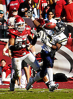 Florida International University Golden Panthers versus the University of Arkansas Razorbacks at Donald W. Reynolds Razorback Stadium, Fayetteville, Arkansas on Saturday, October 27, 2007.  The Razorbacks defeated the Golden Panthers, 58-10...FIU junior running back A'mod Ned (3) (Miami, Fla.) attempts to pull in a Wayne Younger pass as Arkansas defensive end Adrian Davis (53) watches.