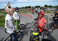 James Stevenson of Rogers (left), who has been riding since 1974, Saturday, Aug. 1, 2020, during a workshop led by Stevenson at the pump track at Runway Bike Park at The Jones Center in Springdale. Stevenson and several local riders spent the morning teaching young riders how to navigate the pump track and how to position themselves on their bicycles. Visit nwaonline.com/200803Daily/ for today's photo gallery.<br /> (NWA Democrat-Gazette/Andy Shupe)