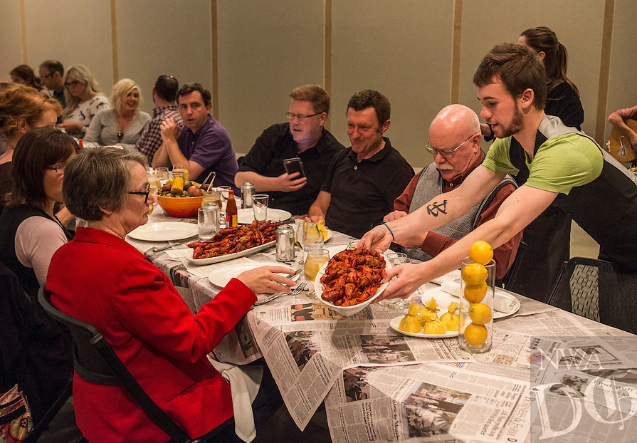 NWA Democrat-Gazette/ANTHONY REYES &bull; @NWATONYR<br /> Diners are served crawfish Wednesday, April 15, 2015 at The Hive's crawfish boil block party, inside the 21C hotel in Bentonville. Many boils happen this time of year. The Hive's boil featured a four course meal with crawfish flown in fresh from the gulf coast. Chef Matt McClure created each dish.