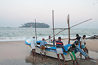 It takes manpower to launch the fishing boats each morning at Beruwala, Sri Lanka