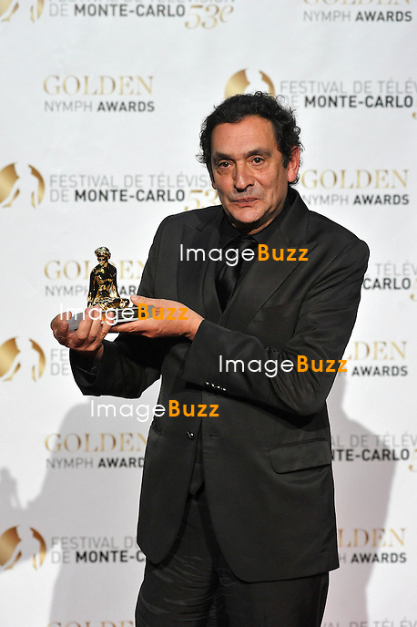CPE/June 13, 2013-Director Agusti Villaronga poses with his Golden Nymph Awards during the closing ceremony of the 2013 Monte Carlo Television Festival. Golden Nymph Awards Photocall.